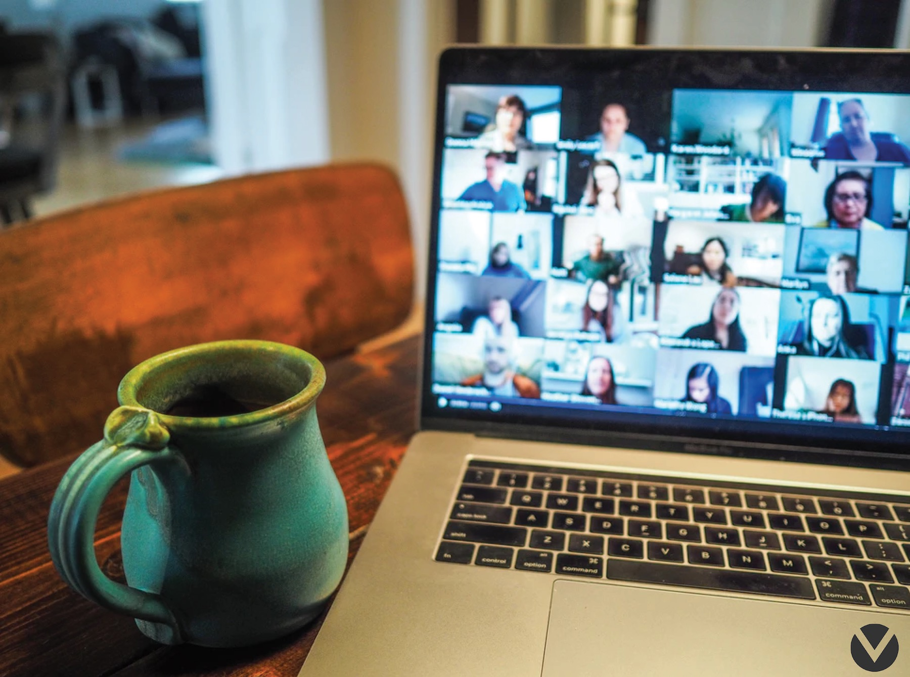 laptop with a mug next to it on a zoom call